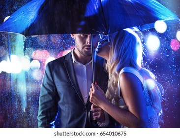 Attractive young couple on a rainy date