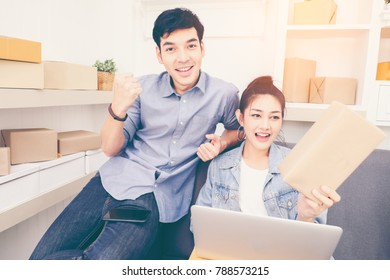 Attractive young couple people startup for small delivery business at home. Cheerful Asian Business Smilling People, Online Business, Owner business concept. Vintage tone.