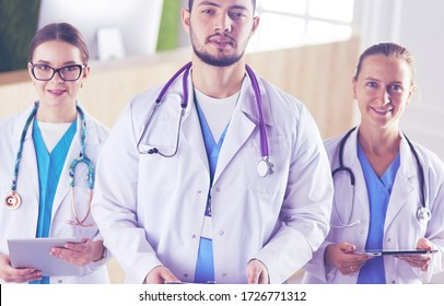 Attractive young doctor with his young colleagues
