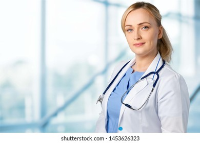 Attractive young female doctor student on background