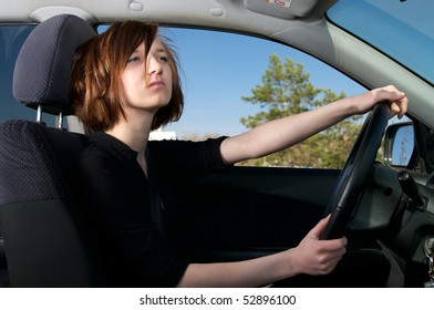Attractive young female driving car