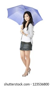 Attractive young female holding a violet umbrella over a white background