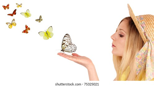 Attractive young girl blowing on butterflies.Isolated on white background