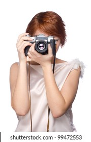 Attractive young girl with a camera over white background