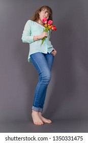 Attractive young girl with colourful tulips