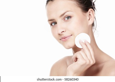 Attractive young girl with a cotton disc