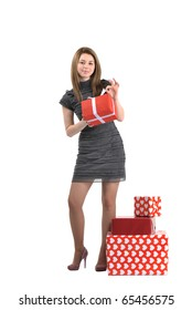 attractive young girl with gift boxes on white background