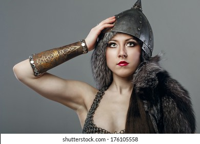 Attractive young girl with historical armor shot in studio