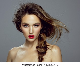 Attractive young girl with red lips and messy hair