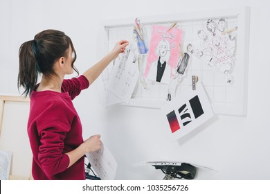 Attractive young girl in stylish clothes by mood board
