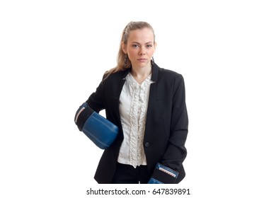 an attractive young girl with a tail stands in shirt and jacket looks straight and keeps a hand on the side of the Boxing Glove
