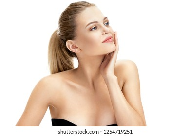 Attractive young girl touching her face isolated on white background. Youth and skin care concept