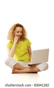 Attractive young girl using notebook computer. All on white background.