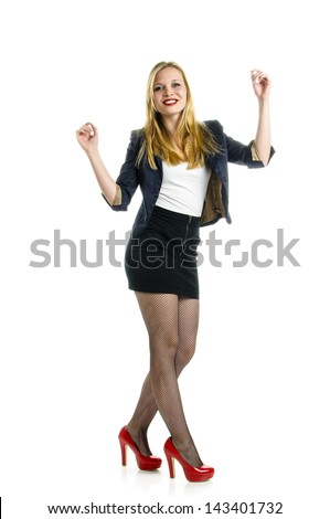 c7da1c067 Attractive young girl wearing black miniskirt und red high heels and  dancing isolated against white background