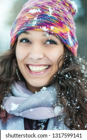 Attractive young girl in wintertime outdoor.