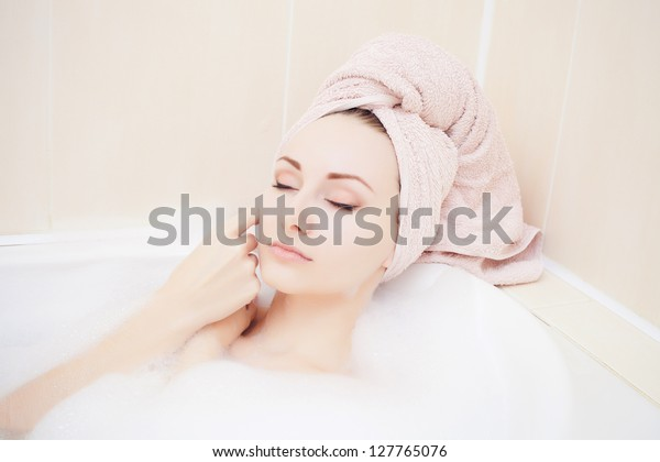Attractive young gorgeous women taking bath