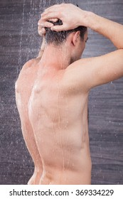 Attractive young guy is cleaning his body