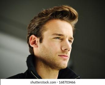 Attractive young guy posing in studio