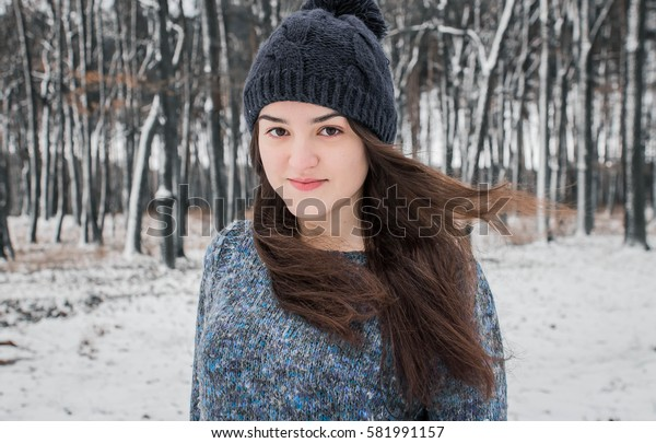 Attractive young and happy girl in wintertime outdoor in forest