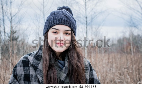 Attractive young and happy girl in wintertime outdoor