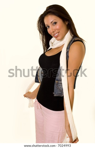 Attractive young Hispanic American woman wearing casual attire with a white scarf