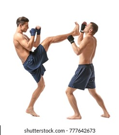 Attractive young kickboxers fighting on white background