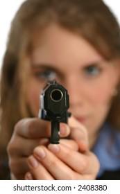 attractive young lady aiming handgun, gun in focus