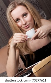 Attractive young lady with a cup of tea