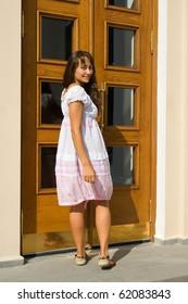 Attractive young lady entering the door