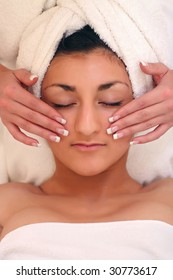An attractive young lady getting a facial