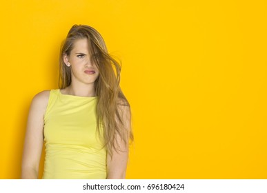 Attractive young lady having problem with her hair. Bad haircut with split ends. Female hair care trouble