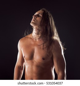 Attractive young male, athletic body type, long hair, pensive face