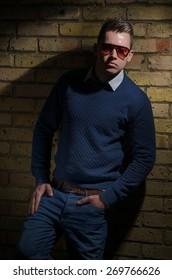 Attractive young male model in sunglasses