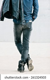 Attractive young man in back with smartphone in his pocket