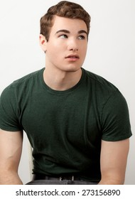 Attractive Young Man in Green Shirt