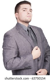 attractive young man with a grey suit and a tie posing