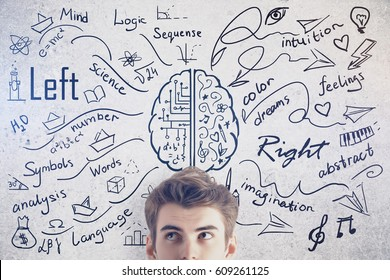 Attractive young man on concrete background with creative sketch. Different brain sides concept