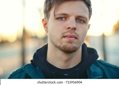 Attractive young man outdoors.Closeup portrait of a young handsome man .