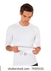 Attractive young man reading a letter. All on white background.