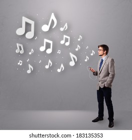 attractive young man singing and listening to music with musical notes getting out of his mouth