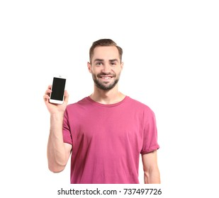 Attractive young man with smartphone on white background