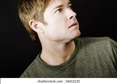 Attractive young man with space for copy