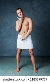 attractive young man with a towel after shower