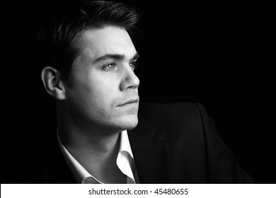 attractive young man in a vintage black and white low key setting