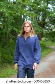 Attractive Young Man Walking Path in Woods