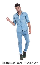 attractive young man wearing denim, snapping fingers and walking, standing isolated on white background, full body, full length