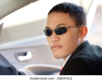 Attractive Young Man Wearing Sunglasses in Car