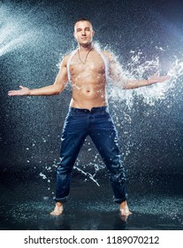 attractive young man with wet clothes  with a splash of water, studio photoshoot