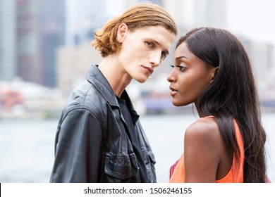 Attractive young, mixed race couple together outside in New York