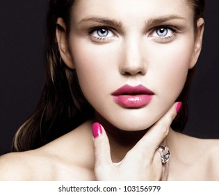 attractive young model with bright make-up and manicure